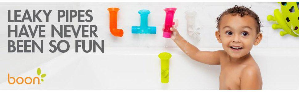 toddler plays with boon bath pipes