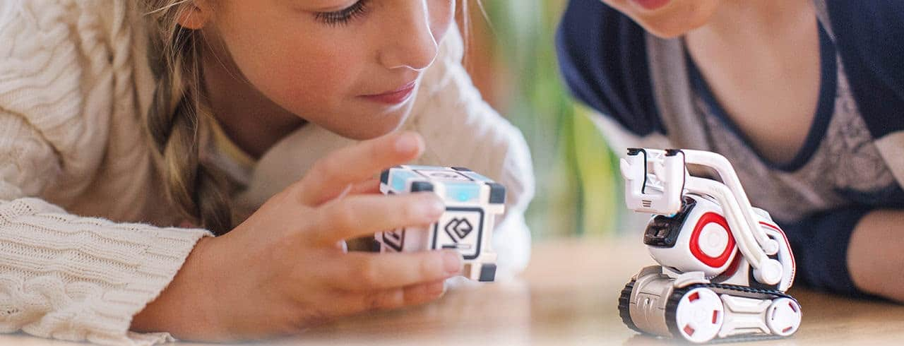 Girl playing with Cozmo blocks