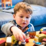 Best Educational Toys for 2-Year-Olds include toy trains for learning STEM skills