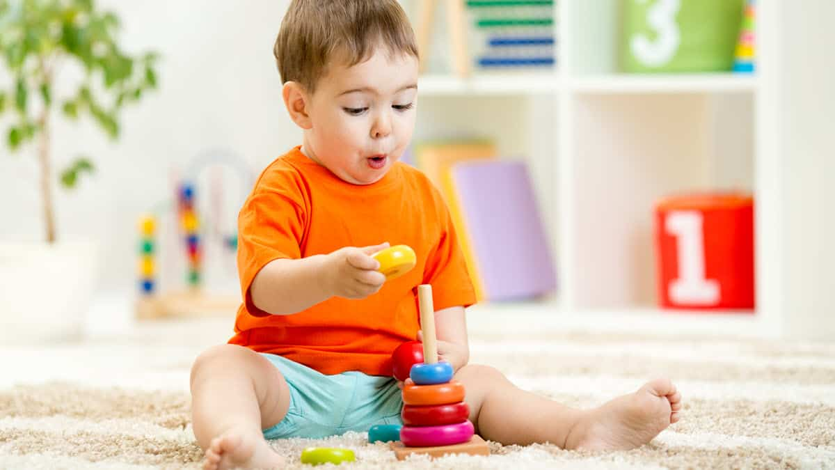 Best STEM Toys for a 1-Year-Old - Baby playing with a stacking toy