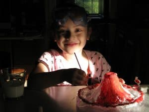 A kid doing a science experiment