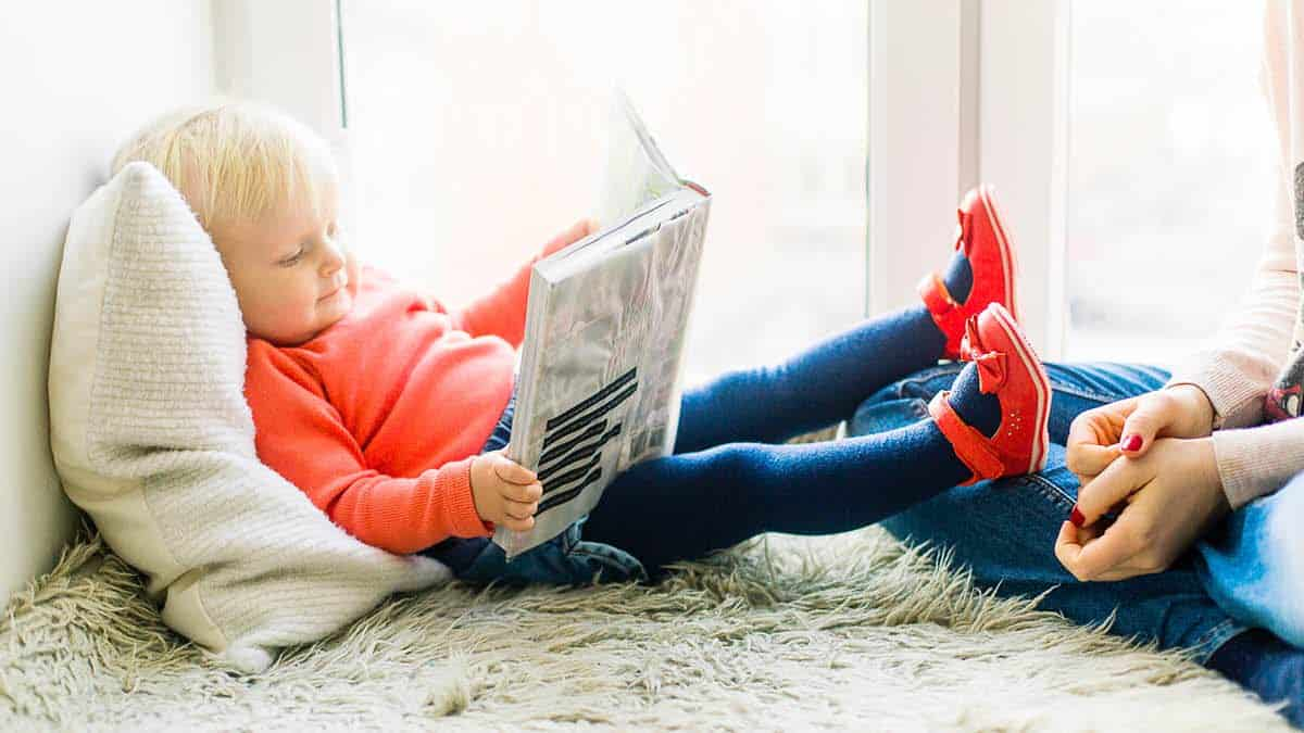 Best STEM Books for Kids - Toddler reading a STEM Book
