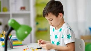 5 Year-Old Boy Playing with a STEM Toy