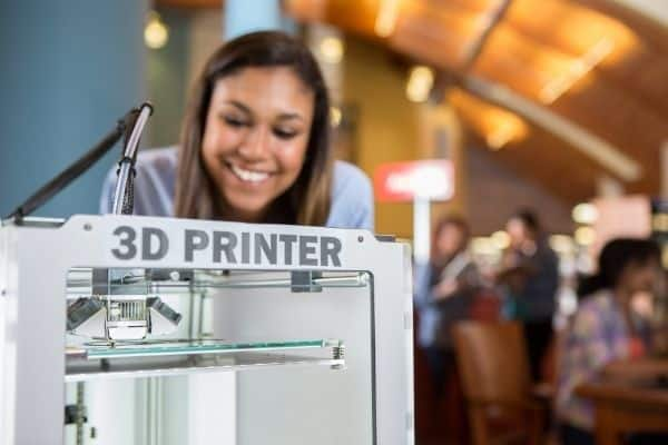 Woman using 3d printer at a makerspace library