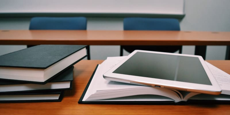 Books and an iPad on a desk