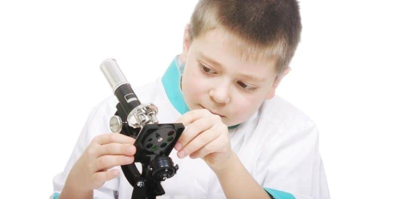 Young boy with microsope