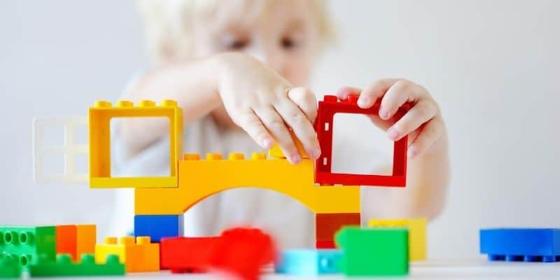 Kid building with LEGO