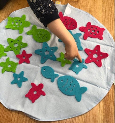 Ocean Sort from KiwiCo - a sorting game that helps toddlers develop their memory and logic skills
