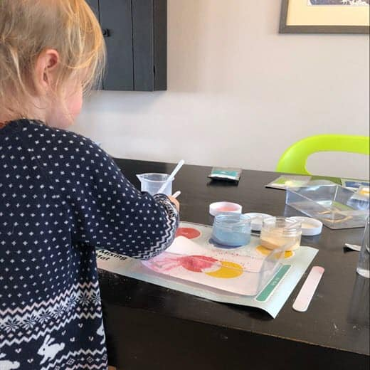 Toddler exploring chemistry - Colorful Chemistry Kit in action
