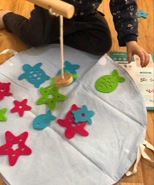 Toddler fishing game - a great STEM activity that promotes fine motor skills