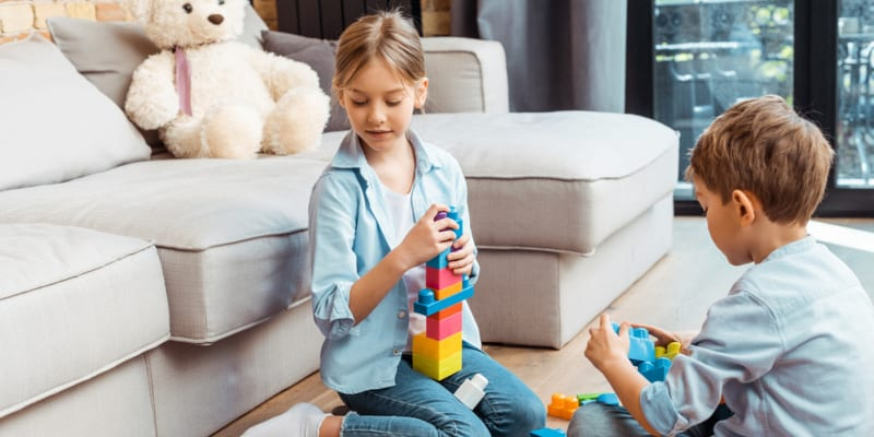 10 year olds playing with building blocks