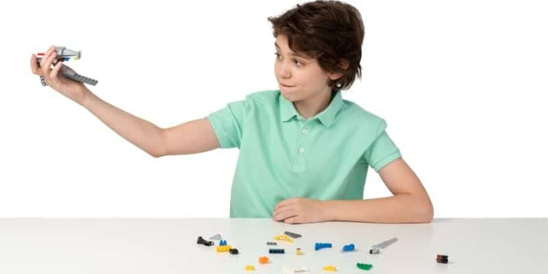 Young boy playing with an educational toy