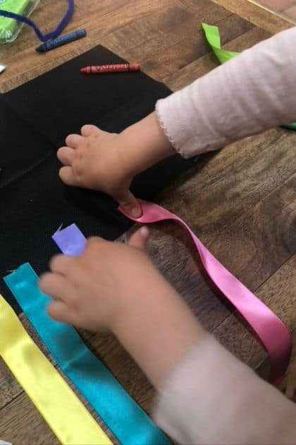 Gluing the ribbon streamers to our wind sock
