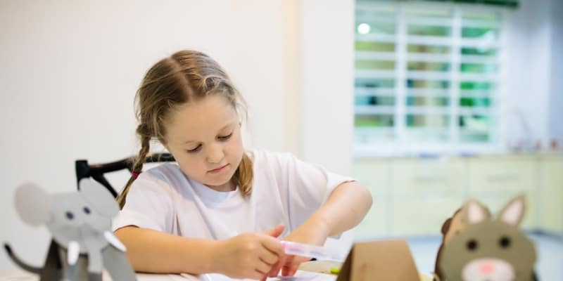 Kid playing with craft kit