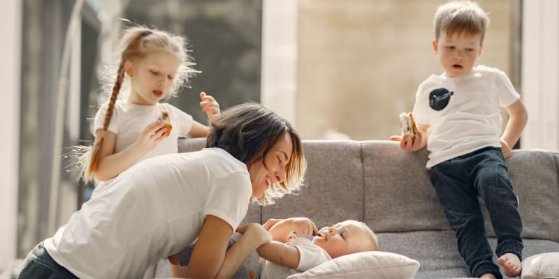 Mother with three kids at home
