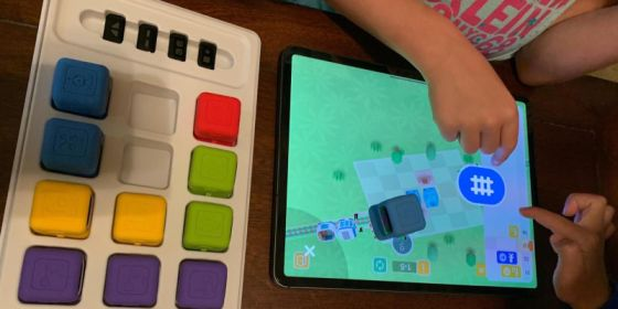 Children using the app to input commands through the robots