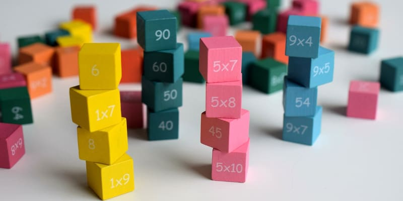 Use math cubes to solve problems in escape room activity