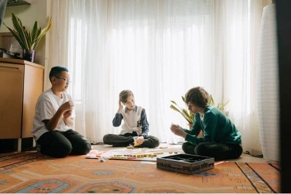 Kids playing educational board game at home