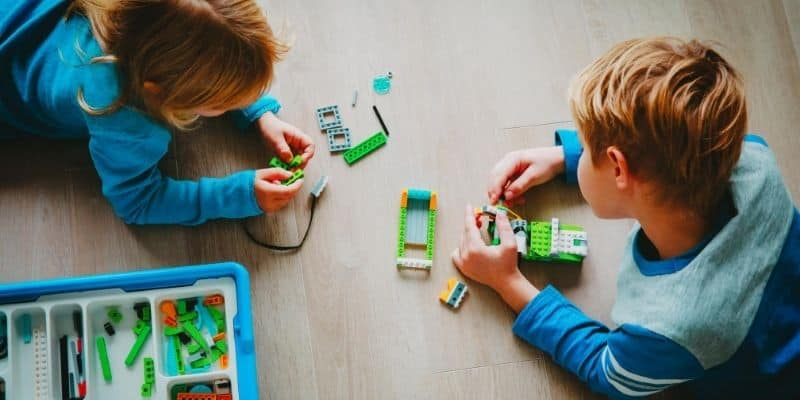 Children playing with robot for kids
