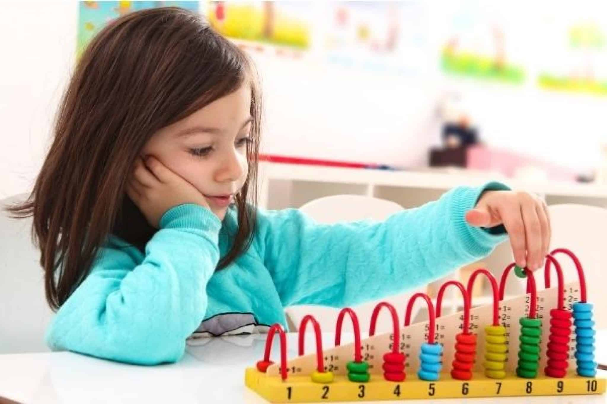 Preschooler playing with educational toy