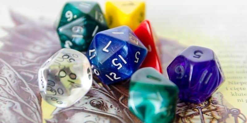 Colorful dice on top of D&D book
