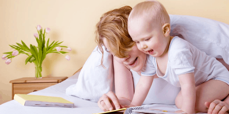 Mother and child looking at shape books