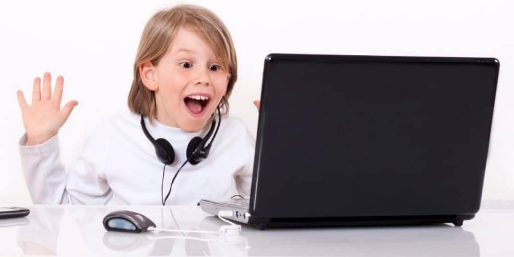 Happy child in front of a computer