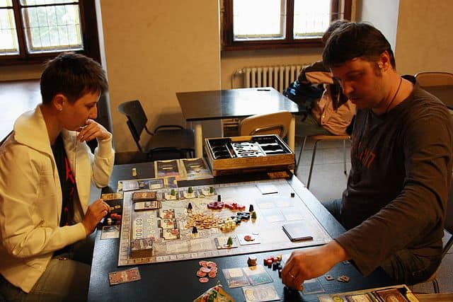 Two people playing Lords of Waterdeep
