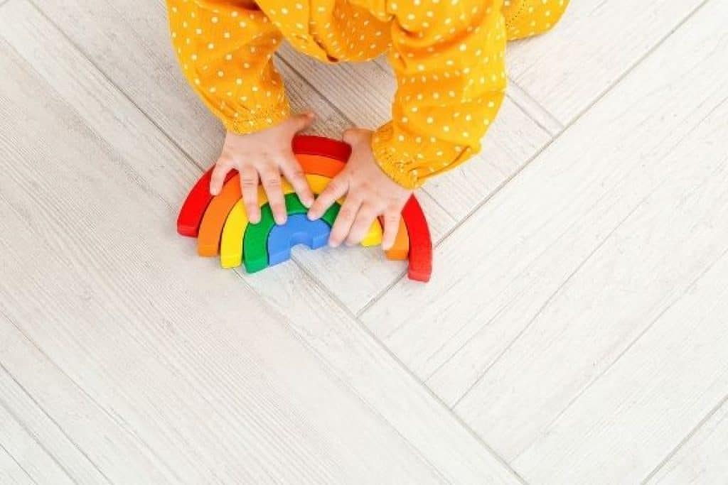 Kid holding wooden toy