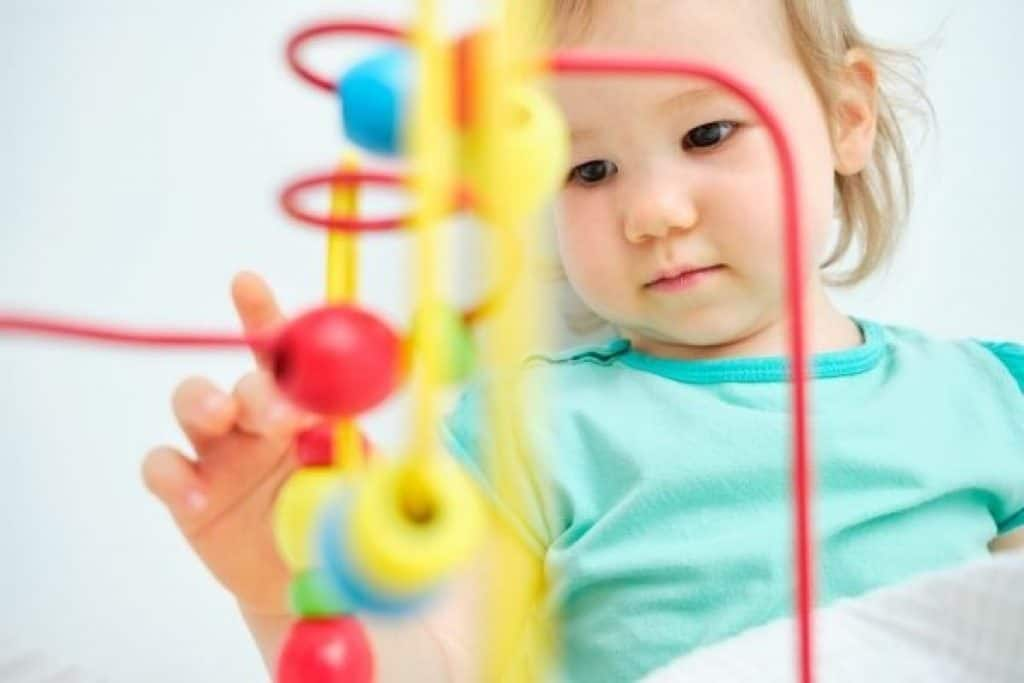 Child playing with learning toy