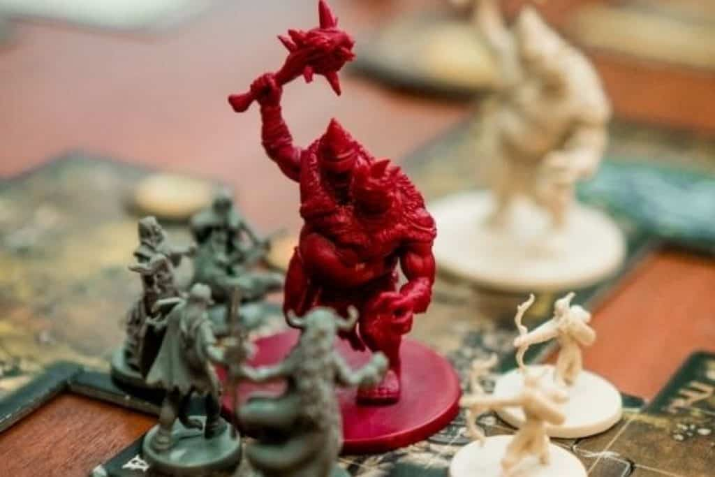 Board game with action figures