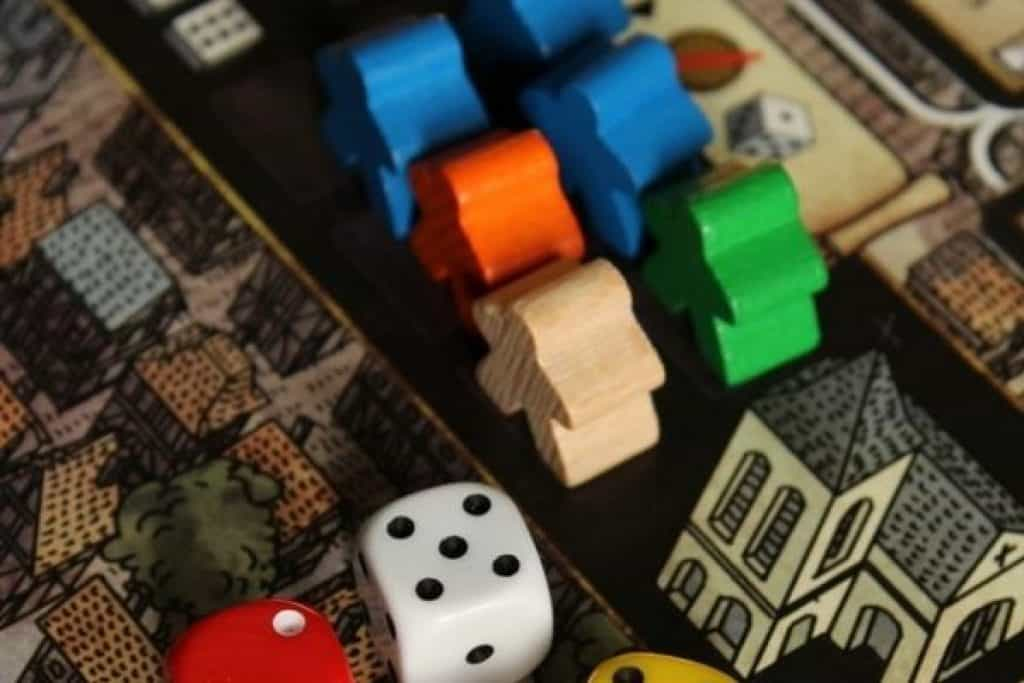 Tabletop game with meeples and dice