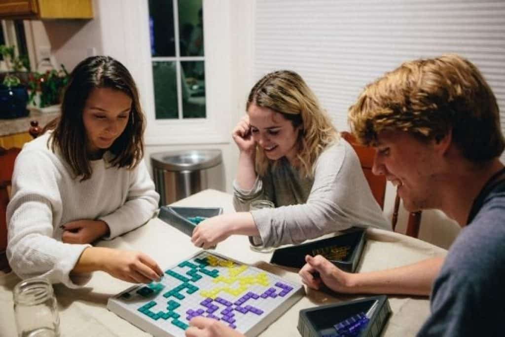 Teenagers playing board game