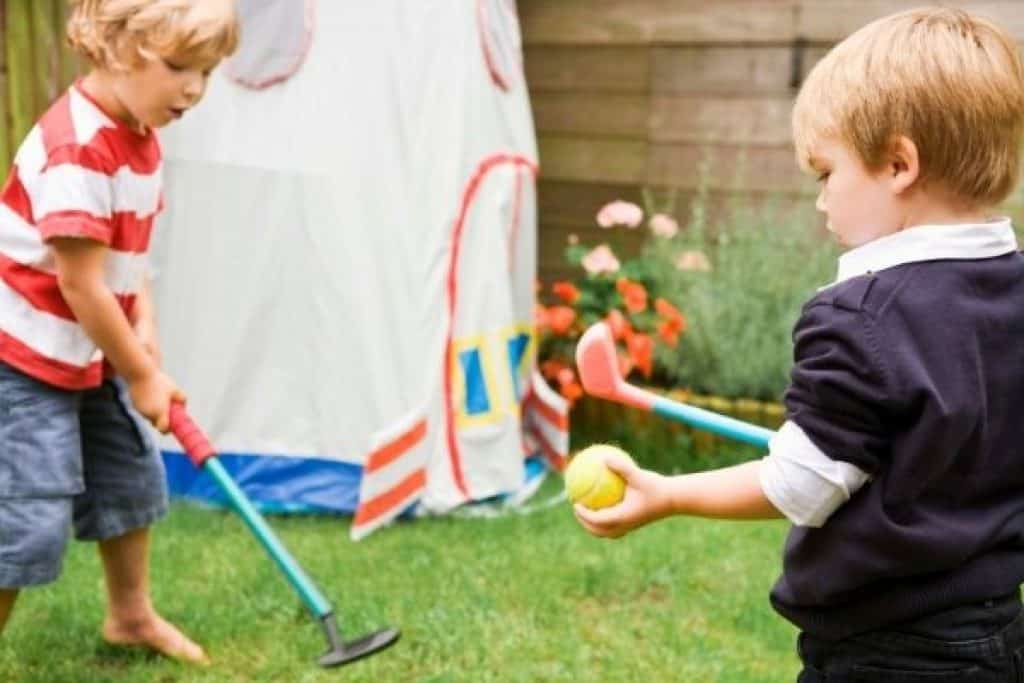 Little boys playing with outdoor toys