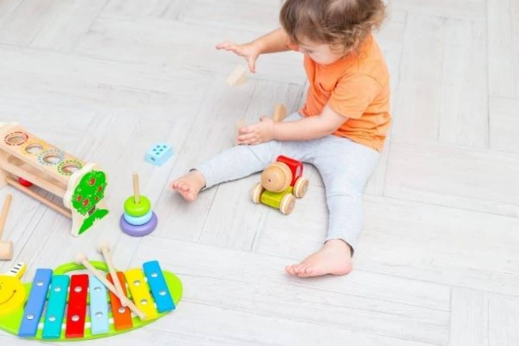 Toddler playing with educational toys