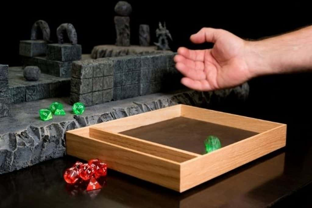 Person rolling dice while playing DnD