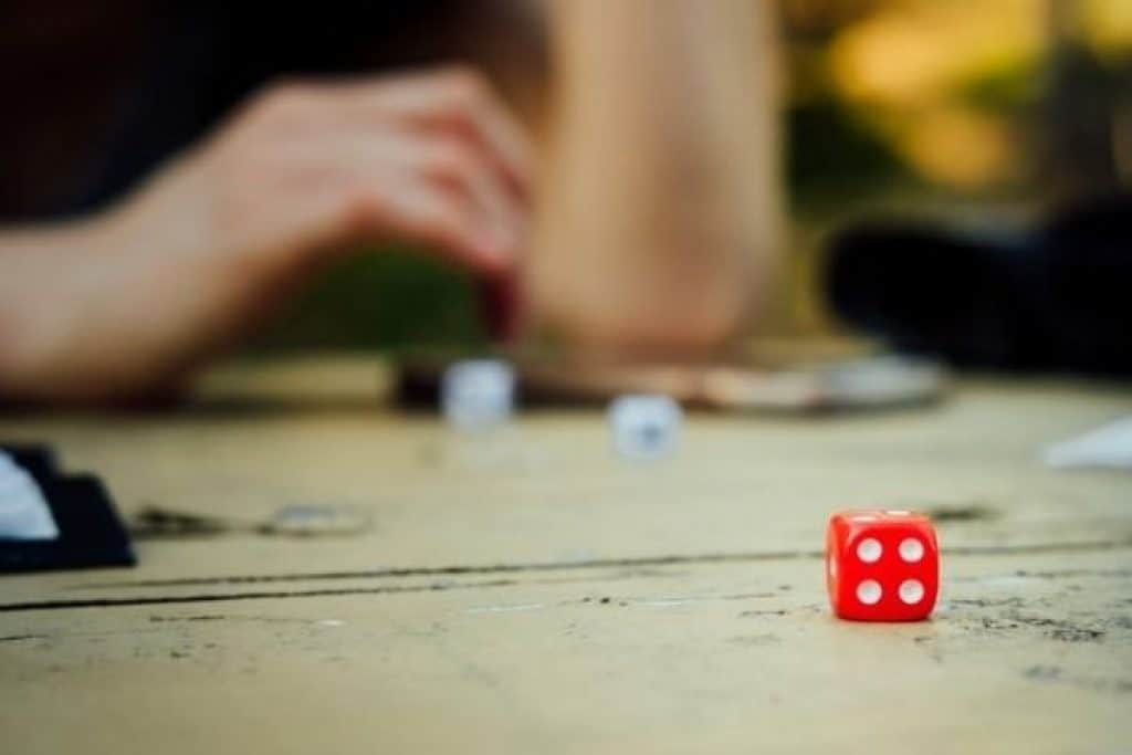 People playing board game with dice