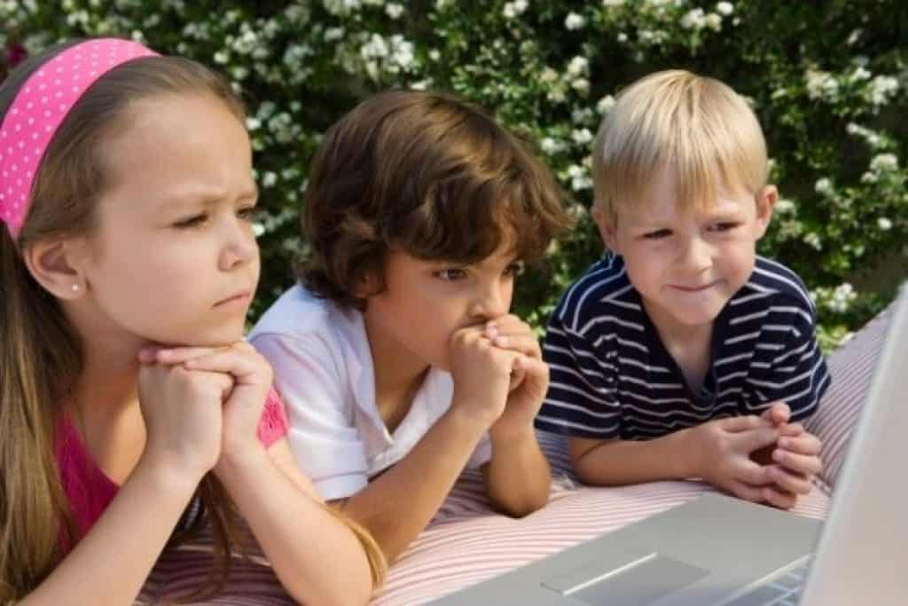 Kids watching a video on laptop