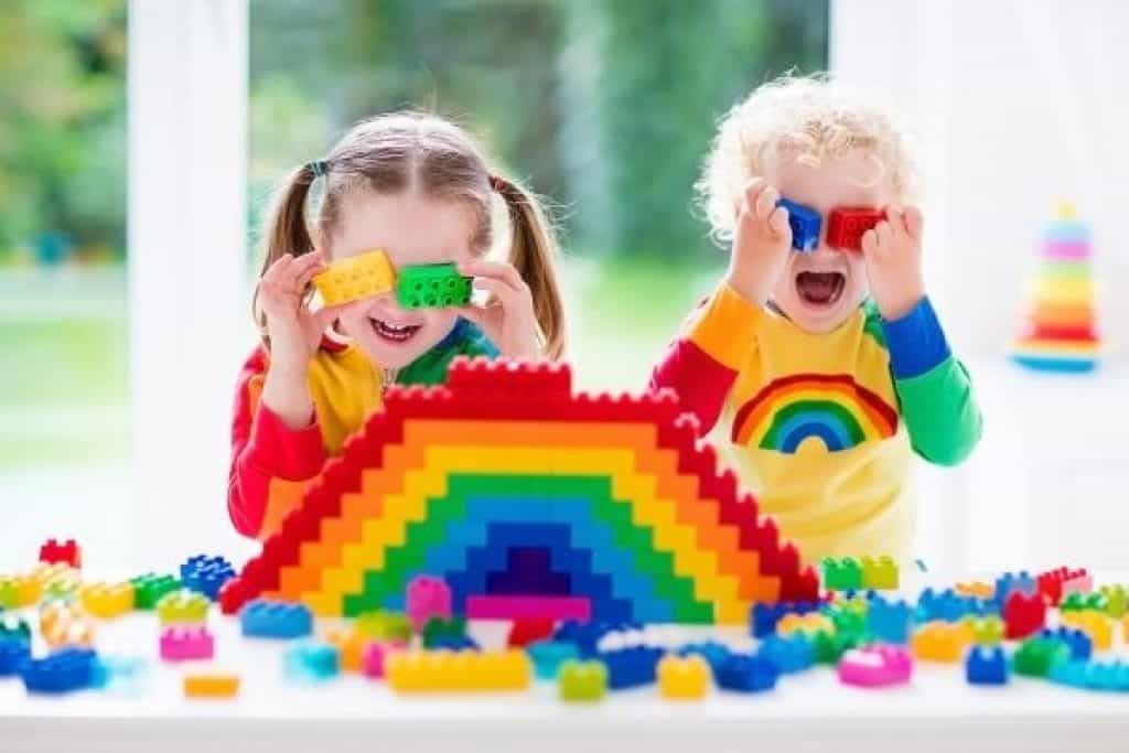 Siblings playing with colorful learning toys