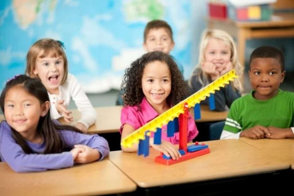 Elementary students with STEM toy