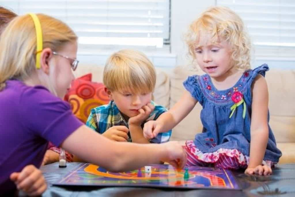 Children happily playing a board game