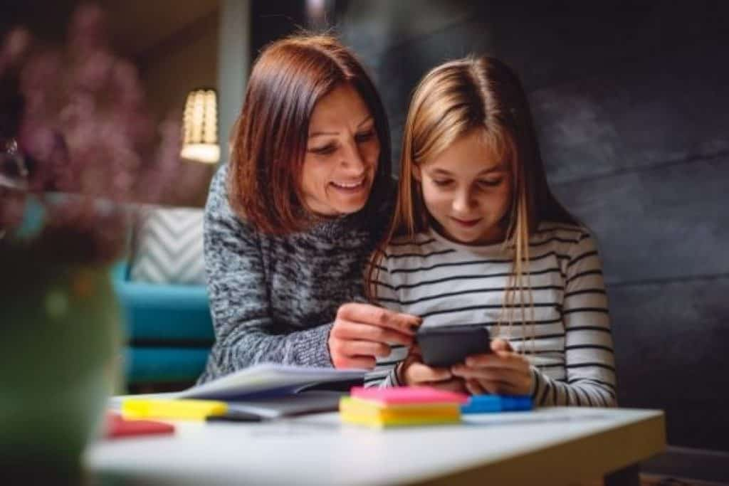 Mother and child doing stop motion animation using mobile phone