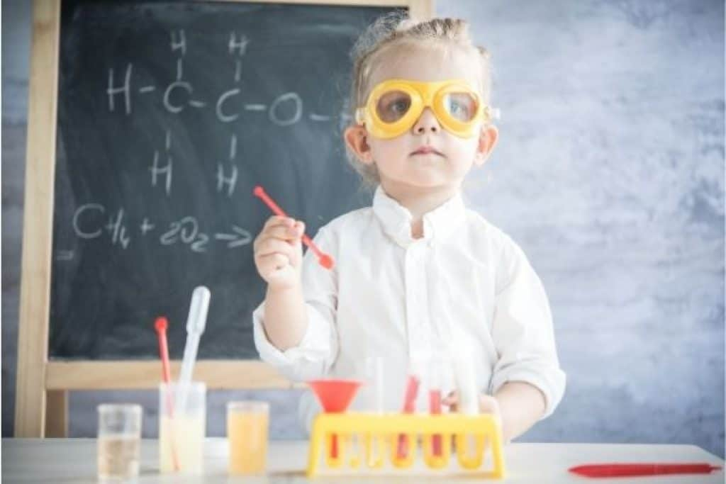 Kid playing with science kit