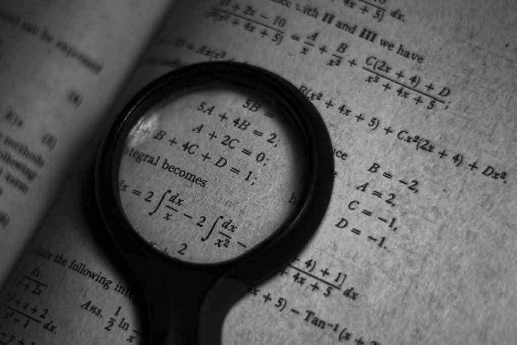 Magnifying glass on math book