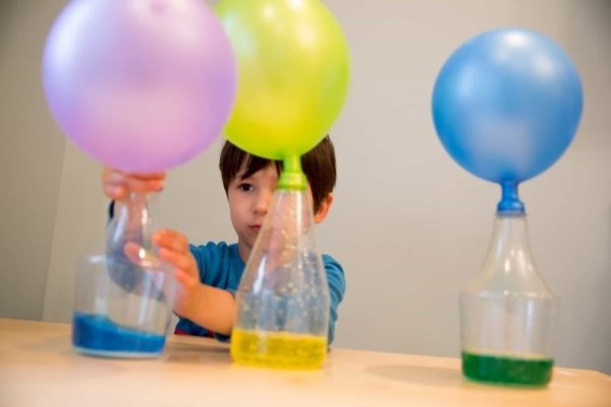 Child doing STEM project with balloons