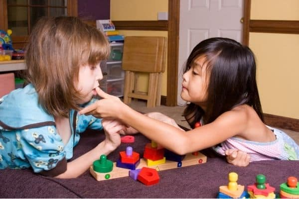 Children playing with toys for nonverbal autism