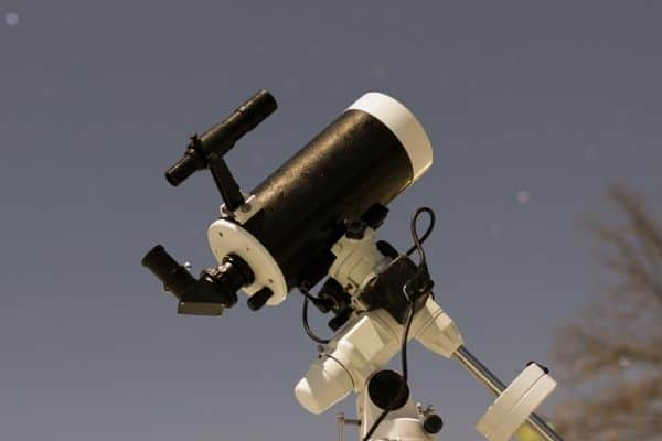 Computerized telescope set up outdoors for star viewing