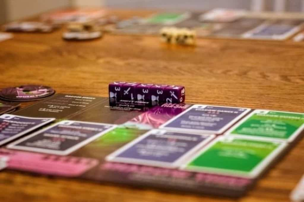 Card game with purple dice