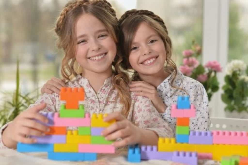 Girls playing with colorful toys