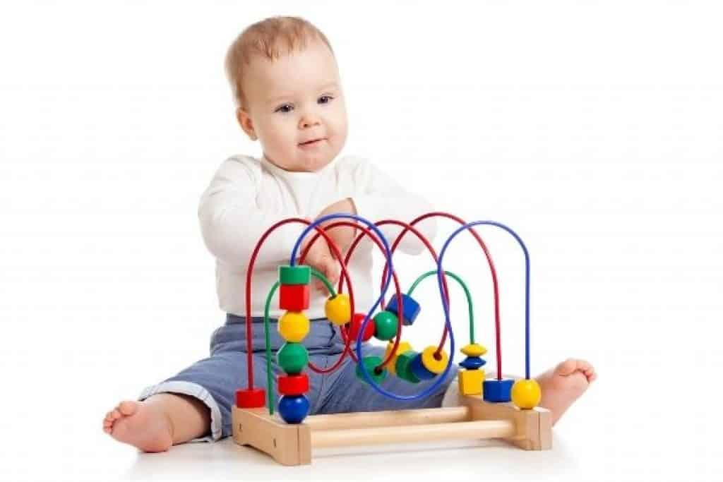 Toddler with colorful STEM toy
